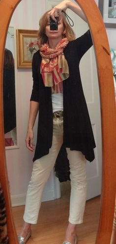 dressing over 50 - travel outfit, black sweater repel stains, scarf adds color, gold flats add sparkle and it's all super comfy
