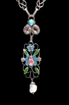 Georgie and Arthur Gaskin. Arts and Crafts necklace. Silver and enamel, set with tourmalines, turquoise with a baroque pearl drop. In the collection of Birmingham Museum and Art Gallery. View 2.