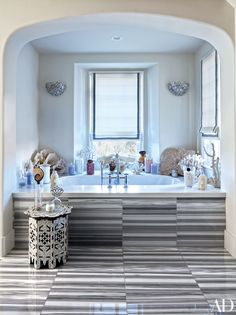 Khloe Kardashian bathroom, with ethnic influences and a lot of accessories.