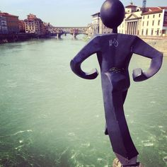 Sculpture by Clet overlooking the Arno River and Ponte Vecchio Florence March 2014
