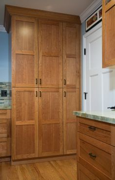 Sunnyvale, CA: Cabinetry hides washer & dryer. Valley Home Builders.