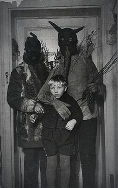 creepy scary vintage black and white men in devil costumes carrying sticks n such. Pretty horrific for that kid.