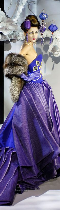 Christian Dior - I love this, dress, stole, gloves...What the heck is she doing wearing paper lanterns on her head?