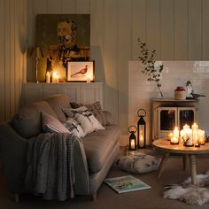 Hygge home decorating idea. Cozy living room with round small coffee table and ivory sofa Cottage Living Rooms, My Living Room, Home And Living, Small Cottage Interiors, Living Room Candles, Home Candles, Simple Living, Modern Living, Casa Hygge