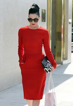 Classic: the red dress, the red lip, the dark shades and the simple bun. Could use a small pearl necklace. Undoubtedly paired with a sexy pair of black pumps... or leopard!