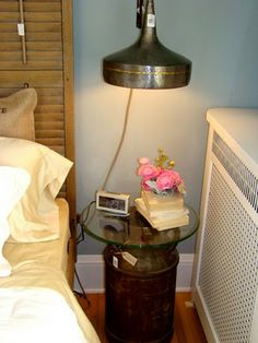 Old milk or cream can made into night stand.  I just bought a slew of them at an auction.  Yay me!