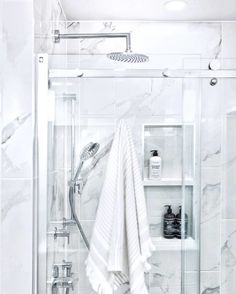 We love this striking shower designed by MAG Interior Design! It's got everything you can ask for - clean, crisp & classic 🚿🤍 🛠: Rietkerk Construction Countertop Store, Marble Showers, Bathroom Gallery, Stone Countertops, Wall Tiles, Crisp, Construction, Flooring, Interior Design