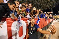 Alex Morgan and fans after Team USA played Thailand at MAPFRE Stadium in Columbus, Ohio, on Sept. 15, 2016. (Jamie Sabau/Getty Images)
