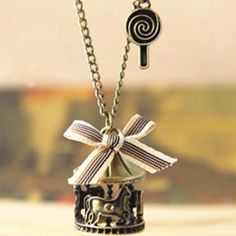 Carousel Necklace Carousel hangs from long thirty inch antiqued brass chain.  Lollipop also on the chain above the carousel.  Ribbon tied onto chain.  Lobster claw closure. I list my lowest prices upfront. Jewelry Necklaces