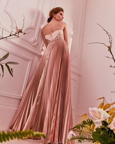 BAND OF GOLD: Opulent rose hues and pleats elevate EFRONA