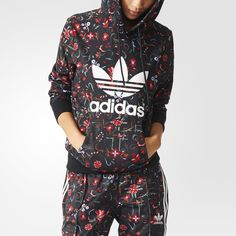 A stylized floral print decorates this women's hoodie. Made in French terry, the sweatshirt features a big Trefoil on the chest.