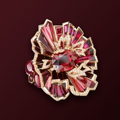 """CHAUMET est une Fête collection- """"Aria Passionata"""" Ring in pink Gold and Lacquer, set with a cushion-cut Vivid Red Pigeon's Blood Ruby of 6.02 carats from Mozambique, 2 cabochon-cut Rubies of 2.20 carats and 1.50 carats, oval-cut, baguette-cut and round Rhodolite Garnets, baguette-cut Rubies and brilliant-cut Diamonds."""