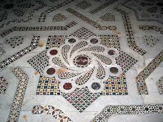 Here is a Cosmati floor mosaic. Cosmati is made of thinly sliced marble cubes, placed in abstract form.