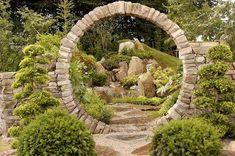 beautiful round stone garden moon gate portal