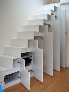 series of tall, narrow closets under these stairs