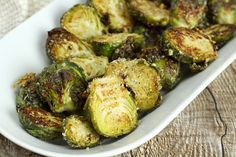 Oven Roasted Garlic Parmesan Brussels Sprouts are coated in olive oil, spices, and parmesan cheese. Then, they're roasted in the oven in just 20 minutes. Parmesan Chips, Garlic Parmesan, Roasted Garlic, Crispy Brussel Sprouts, Brussels Sprouts, Sprout Recipes, Vegetable Recipes, Side Dishes Easy, Vegetable Side Dishes