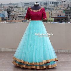 Party wear indian dresses - Gorgeous ice blue and maroon color combination floor length dress with floret lata design hand embroidery gold thread work This out fit is Available from house of Kadhambari They can customize t Girls Frock Design, Long Dress Design, Stylish Dress Designs, Stylish Dresses, Gown Party Wear, Party Wear Indian Dresses, Indian Gowns Dresses, Girls Dresses, Prom Dresses