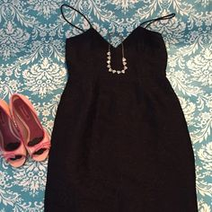 Jcrew little black dress Gorgeous, super sexy black dress. Never been worn and perfect! Has a gold floral stitched print, and is a hip hugging sexy dress that hits below the knee. Small 8 J. Crew Dresses