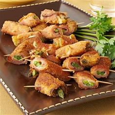 Asparagus Ham Swirls Recipe -I came across the recipe for this hot appetizer years ago and have made it many tomes to share with friends and co-workers. Asparagus, ham and cheese combine into a fun finger food. —Nancy Ingersol, Midlothian, Illinois