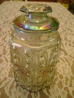 Beautiful Carnival Glass Biscuit/Cookie Jar With Brilliant Rainbow Of Colors With Embossed Design. $22.00, via Etsy.