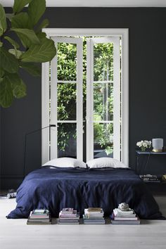 gravityhome:  Source: Cultiver   Lots of natural light and crisp white trim keep this moody and sophisticated bedroom from feeling too overbearing.