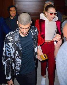 Staying close: Gigi starred in the music video for Pillowtalk, where the duo are seen kiss...