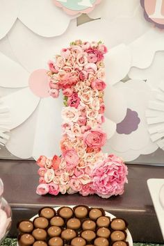 DIY a cardboard number one and cover it in flowers, real or fake, for a classy and pretty way to display the big number. | First Birthday Party Decorations: Flower One | Photo: Adam Frazier Photography