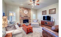 Pretty living room with molding and brick fireplace