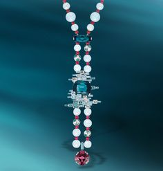 After the rain : red spinels, aquamarines and indicolite tourmalines conjure up images of nature after a rain shower... Lumières d'Eau long necklace in white gold, aquamarine, spinels, tourmalines, garnets, diamonds.