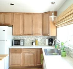 kitchen: soft meadow by glidden (paint), Wilsonart Laminate 'Perla Piazza' countertops, mosaic tile, pendant light