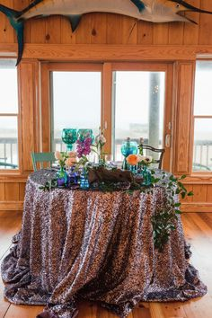sequin linen and teal and purple sweetheart table