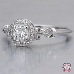 Vintage engagement ring; I wish the diamond was a perfect square but it's still lovely with the scrolling and the pave setting.