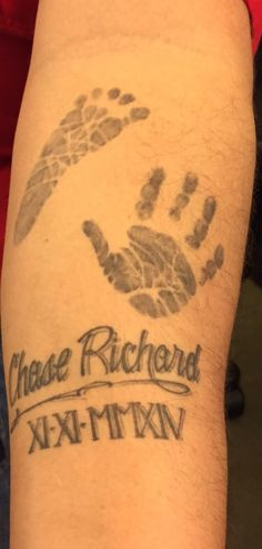 Tattoo of my son Chase's hand and foot print. Done by Cindy Twin Moons Creations. Bellerose, NY.