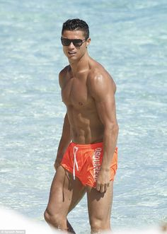 Tiny trunks: Cristiano Ronaldo has been showcasing his wide array of traffic light hued trunks durin...