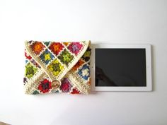 iPad case, iPad cover, iPad sleeve, Jolly Good iPad cosy, colorful, crochet, patchwork, granny square, lady gift, gift for her, organic wool. $50.00, via Etsy.