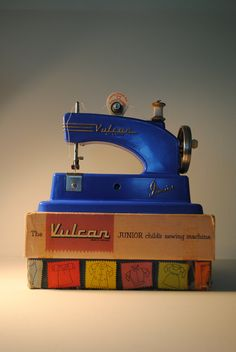 SALE .blue Vulcan childrens sewing machine antique made in England lovely blue with grips vulcan Junior with box