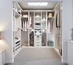 large picture of fitted walk in wardrobe in white wood