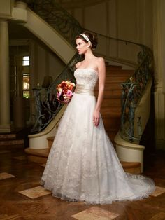 Casablanca Fall 2009 Style 1971      This soft and sophisticated gown features sparkling Swarovski crystals and sequins at the neckline. The waist is embellished with a pleated silk band while delicate embroidery makes the skirt sparkle.