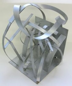 cardboard sculpture painted with metallic paint. Could also just use strips of construction paper and talk about different kinds of lines creating a 3D sculptural form