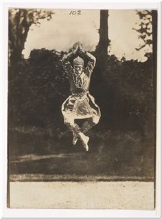 "This photograph of Vaslav Nijinsky is one a series taken by Druet–a self-described ""amateur photographer"" best known today for his dazzling images of Rodin's sculpture–at the request of the painter Jacques-Emile Blanche, in the latter's garden in Passy. The dancer is seen in midair executing one of the jumps for which he was famous and wearing the costume designed by Léon Bakst for ""Danse siamoise,"" a solo in Les Orientales, choreographed by Michel Fokine."