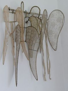 """Victorian angel wings. Apparently, all the beading and sequins were sewn on by nuns, so that the wings could be used by children performing..."