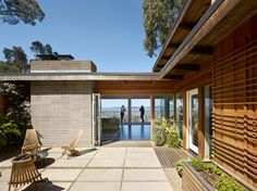 Traditional Entry with Door Mat In Front Of Wooden For Your Home Design: Midcentury Exterior Design With Door Mat And Concrete Block Fireplace And Concrete Pavers In Courtyard Plus Garden Seating And Modern Courtyard Plus Terrace With Wood Exterior