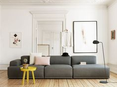 Pastel living room: wooden floors, white walls, grey sofa, and a few colourful accessories. So lovely and peaceful!