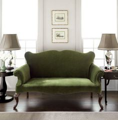 green velvet sofa - would be a cool settee to put at my dining window to also use as dining seating.