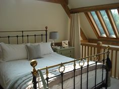 Attic | Bedroom | Interiors | Home | Decor | Beams | Brass Bed |Roderick James Architects