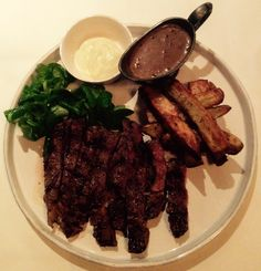 Char grilled ribeye steak, served with Cajun spiced jacket skinned chips; dressed lambs lettuce and a peppercorn sauce.