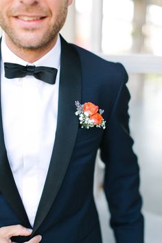 Navy Jacket w/ Black Lining, White Button Up, Black Bow Tie, Light Coral Flower
