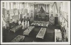 The Burra Hall, South Australia. Bird's eye view of the interior of the Burra Hall, set up with tables for dining and with two Cheer Up Society workers nearby. WWI. SRG 6/34/14.