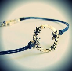 Daisy Circle bracelet...sterling on waxed linen cord. Pretty.