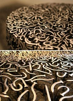 The underlying wood is cut, smoothed and scorched to fade it to the background while the nails on top are ground down to reveal their inner silver shine and stand out visually against the dark wooden surface below.